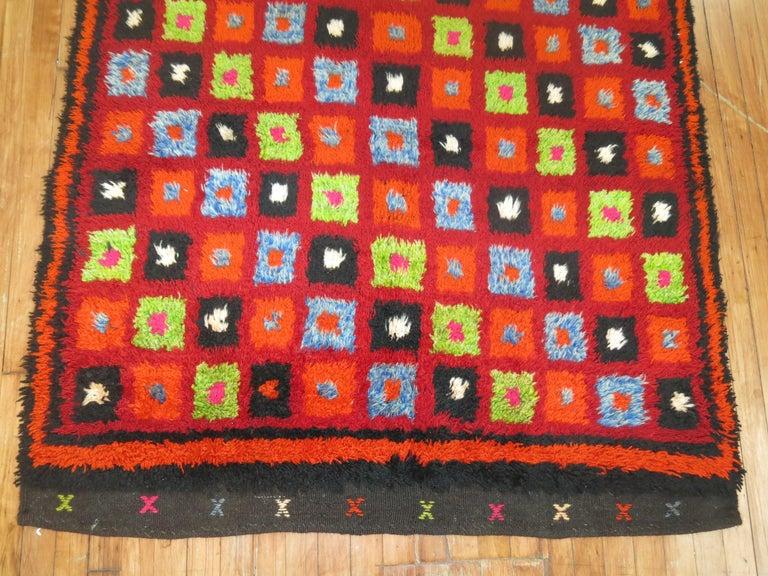 Bright colors highlight this mid-20th century intage Turkish Tulu rug.