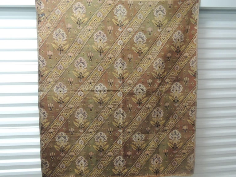 Antique Textile Collection: Vintage Turkish Woven Floral Tapestry Panel. Depicting flowers and vines in shades of yellow, soft orange and green. Could use for upholstery or as a wall hanging. Sold as is. Size: 49 W x 56 L