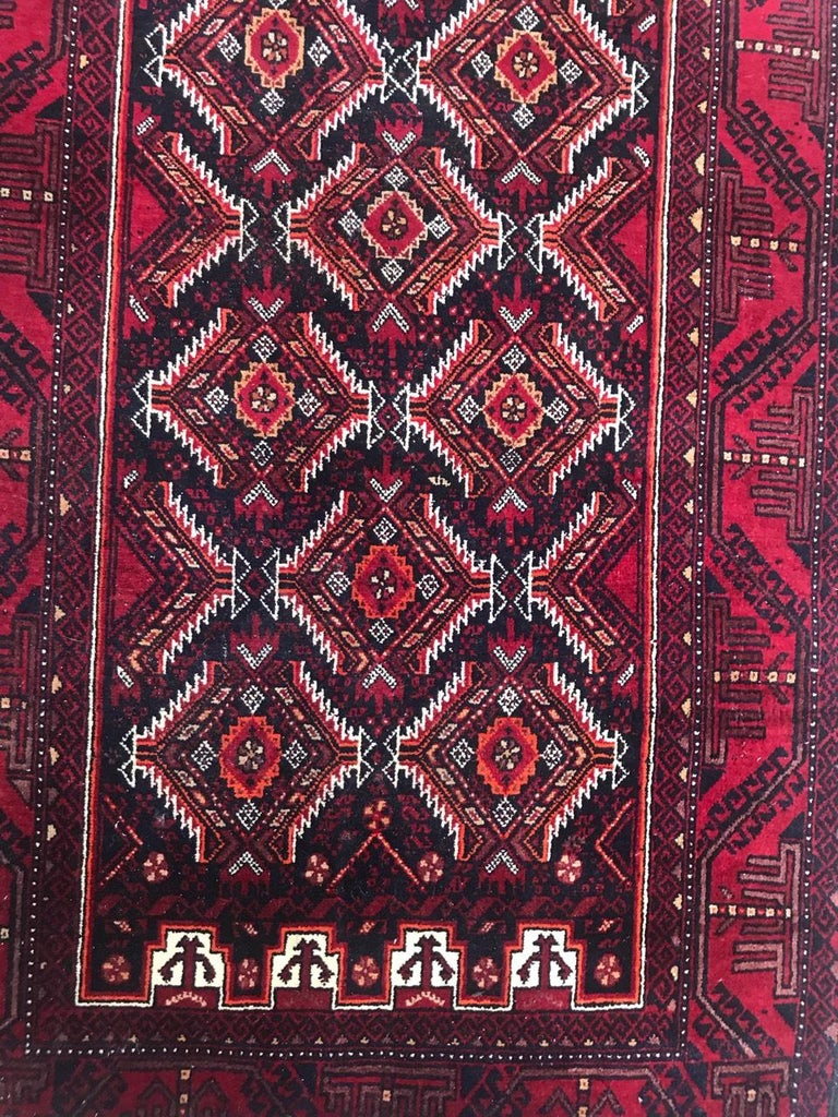 20th century tribal Turkmen Baluch rug from Afghanistan, with a beautiful geometrical design and red and black colors, entirely hand knotted with wool velvet on wool foundation.  Take a look at other Bobyrug items! , search by