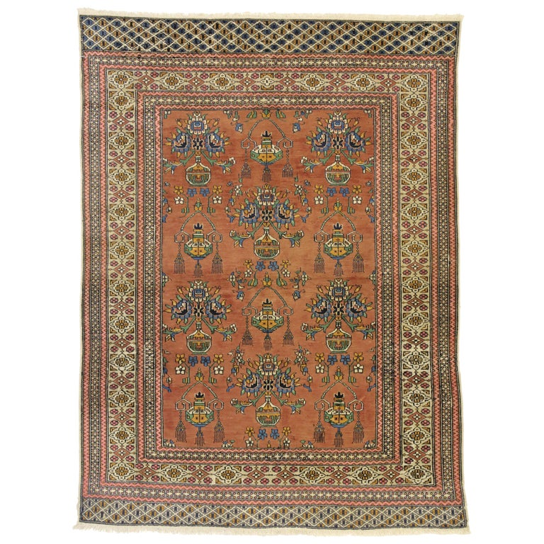 Vintage Turkmen Persian Rug With Floral Vase Design And