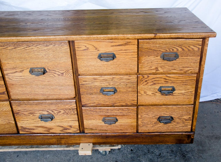 An excellent vintage store counter that would be a wonderful central display accent piece / room divider for a restaurant, clothing store, or specialty kitchen or food store, or just an impressive island in your kitchen. There is lots of storage