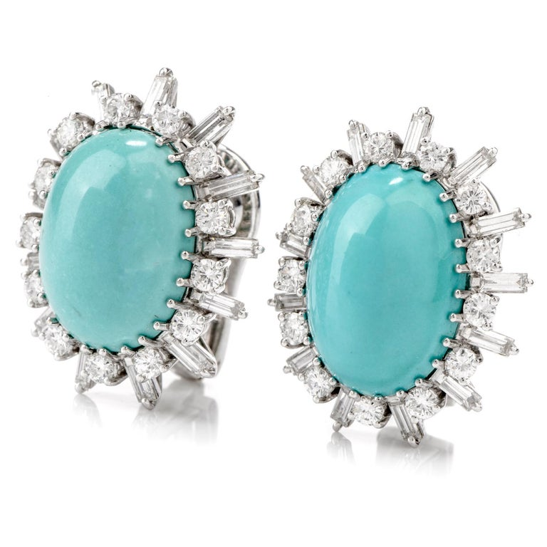 These visually stimulating blue green colored 1960's vintage earrings  feature vibrant oval   shaped Turquoise measuring appx. 15.45 x 11.13mm in each wighing approx. 24.60 cartas in total.  Turquoise is surrounded by 26 alternating round and