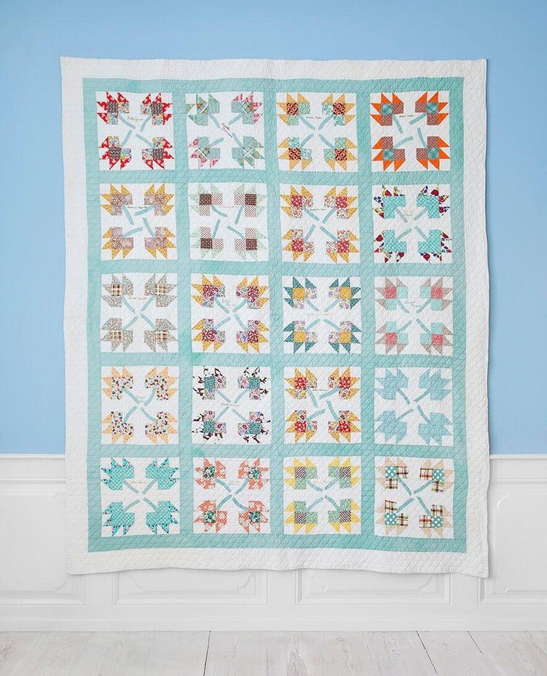 'Autumn Leaf Signature Friendship' quilt with hand appliqued leaf stems and hand embroidered names.