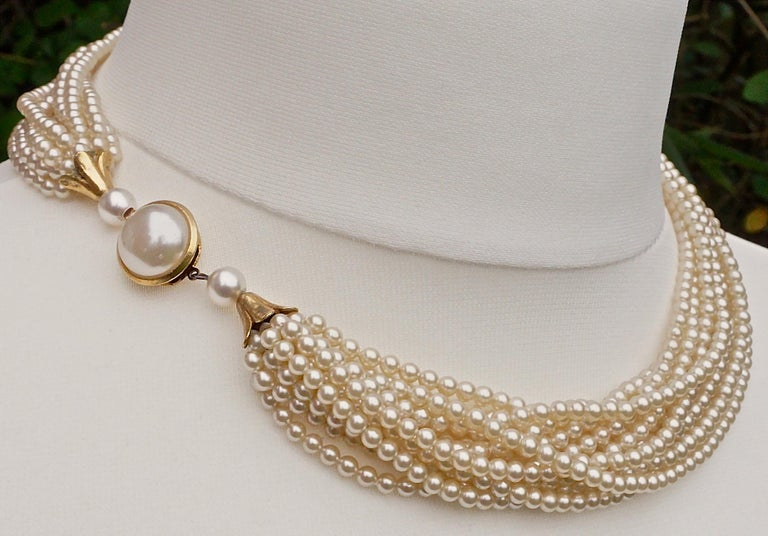 39bfeef397bb2 Twelve Strand Glass Pearl Necklace with a Gold Tone and Pearl Clasp
