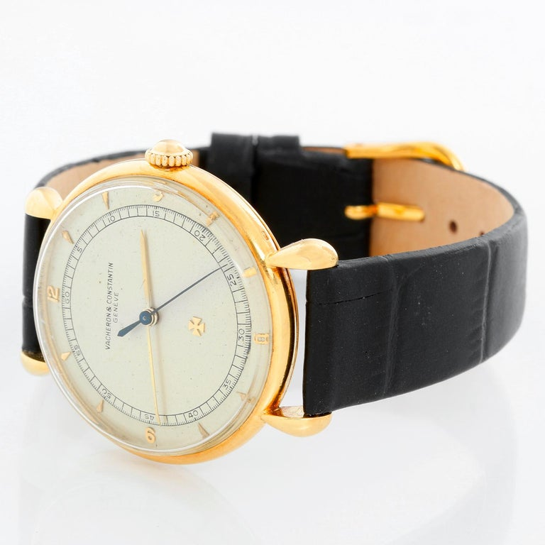 Vintage Vacheron Constantin 18k Yellow Gold Men's Watch - Manual winding. 18k yellow gold case (36 mm diameter). Silver dial with stick markers. Black leather strap with tang buckle. Vintage, pre-owned, with custom box.