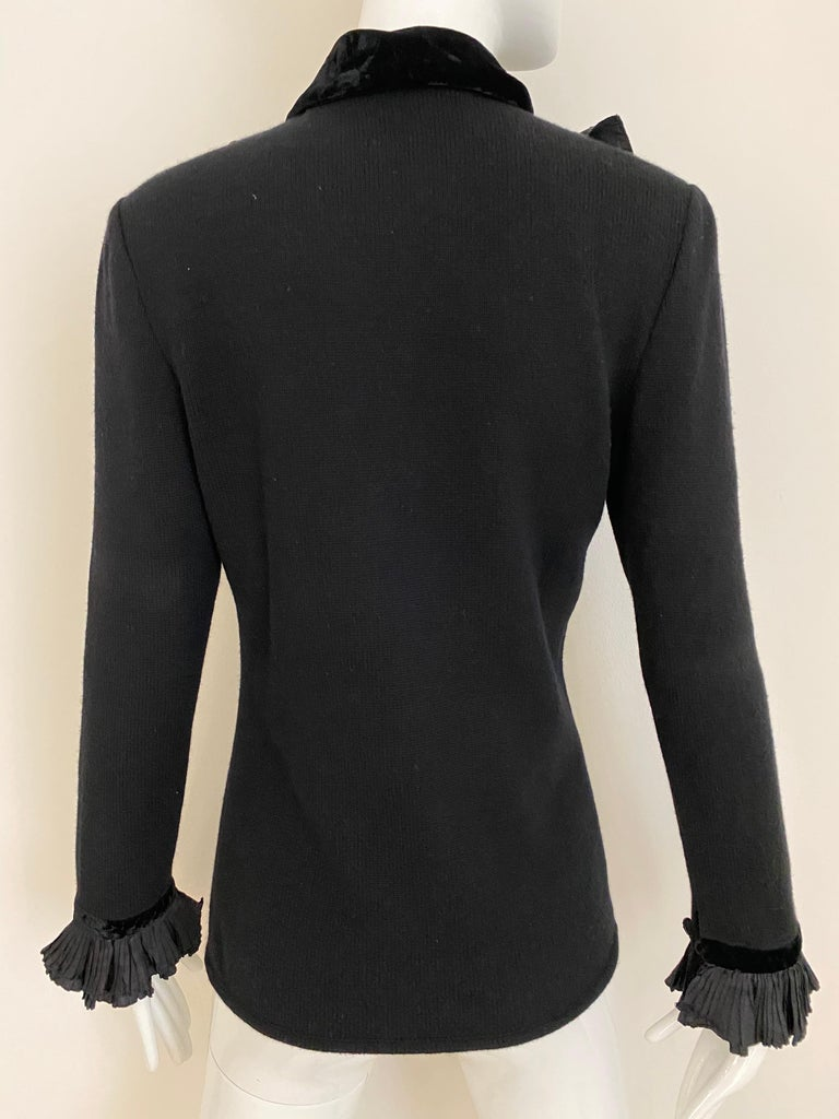Chic 80s Valentino cashmere blend black sweater with large silk bow. Ruffle sleeve with velvet trim. Fit size US 4