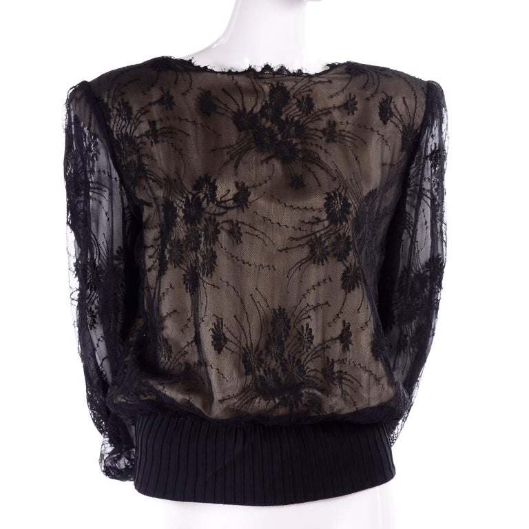 This is an incredible Valentino boutique vintage top with black lace overlay on a nude silk. The blouse almost has the fit of a sweatshirt so it is very comfortable but so elegant!   The sleeves have two layers of lace, and are sheer. It has eyelash