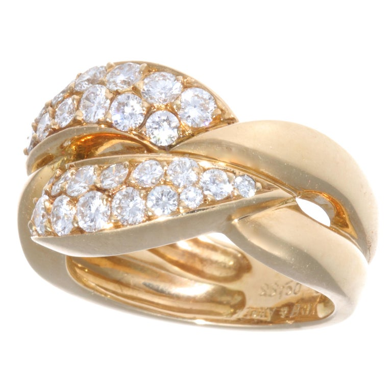 If you like solid gold pieces, accented by diamonds, this vintage Van Cleef and Arpels diamond 18k ring is the one! Vintage, substantial gold pieces are a hot trend right now and are a must have. The ring features 30 round brilliant cut diamonds