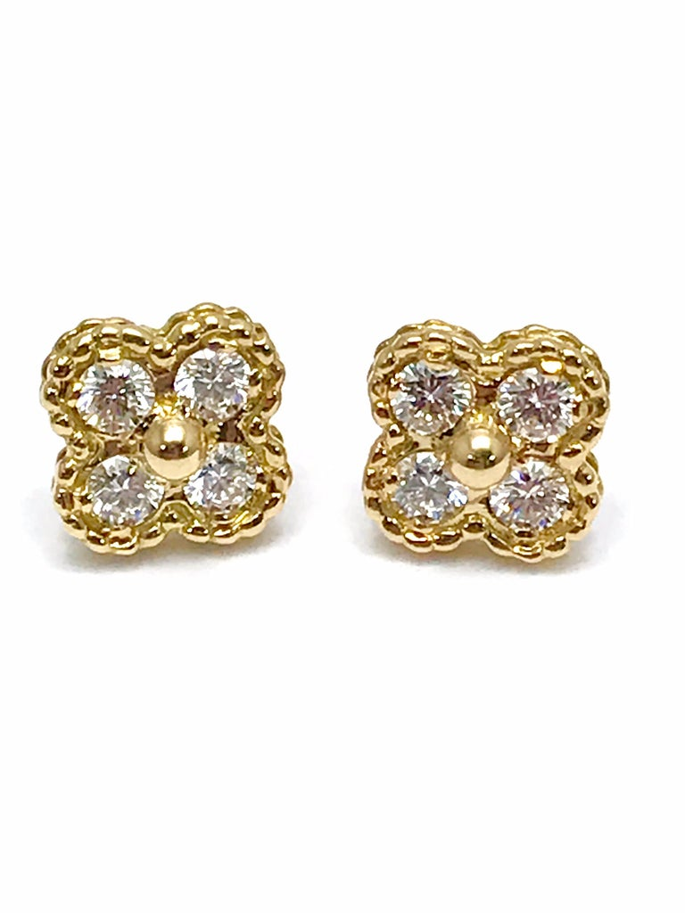 A gorgeoius pair of vintage Van Cleef & Arpels Alhambra Diamond and 18K yellow gold earrings.  These are an iconic piece from the collection.  There are eight round brilliant Diamonds weighing 0.56 carats that are E color, VVS clarity.  The earrings