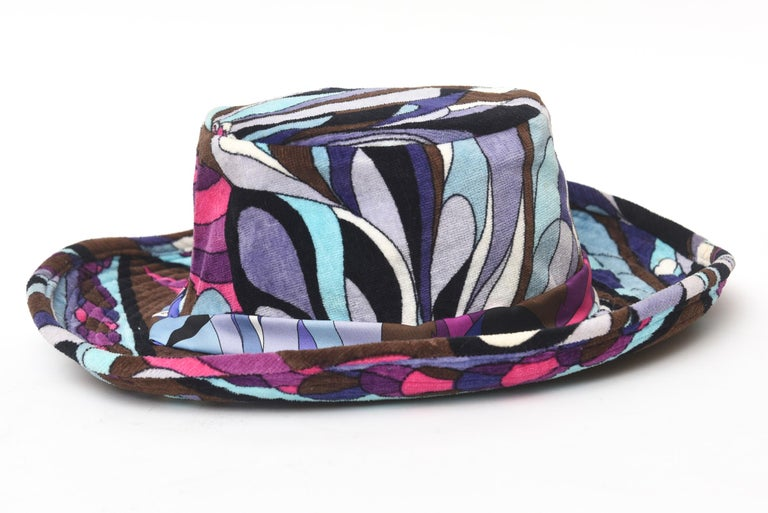 This fabulous vintage Emilio Pucci velvet hat is from the 60's. It has a cowboy style wide brim high center. It is a size small and will fit a very small head. The swirling colors are luscious of hues of brown, black shades of purple and shades of