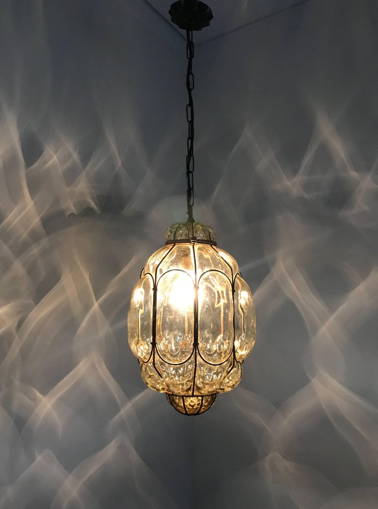 Early 20th century, Italian craftsmanship pendant.   This stylish single light pendant is beautiful in shape and the mouth blown, green tinted glass is in excellent condition. It comes with a chain and metal canopy and the bulb can easily be