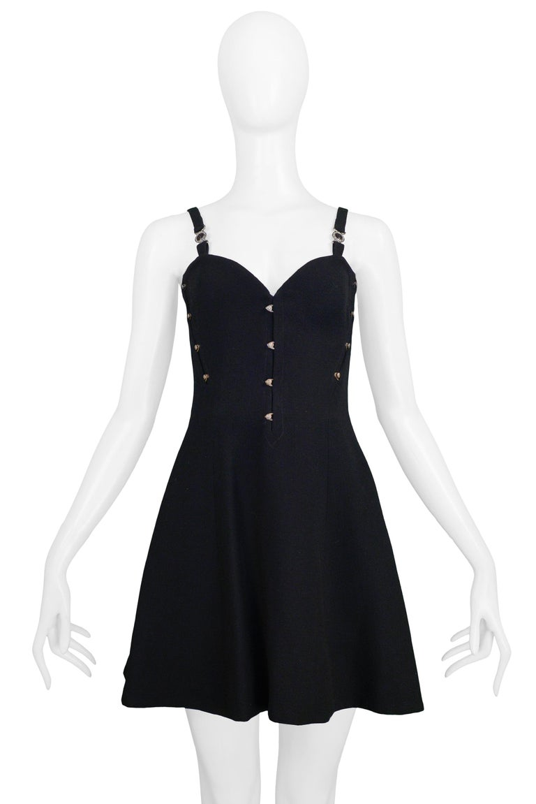 Resurrection Vintage is excited to offer a vintage Versace black bustier mini dress featuring a fitted bodice with goldtone metal tabs, Medusa medallions on the straps, and skater style skirt.   Versace  Measurements: Approx Bust: 32
