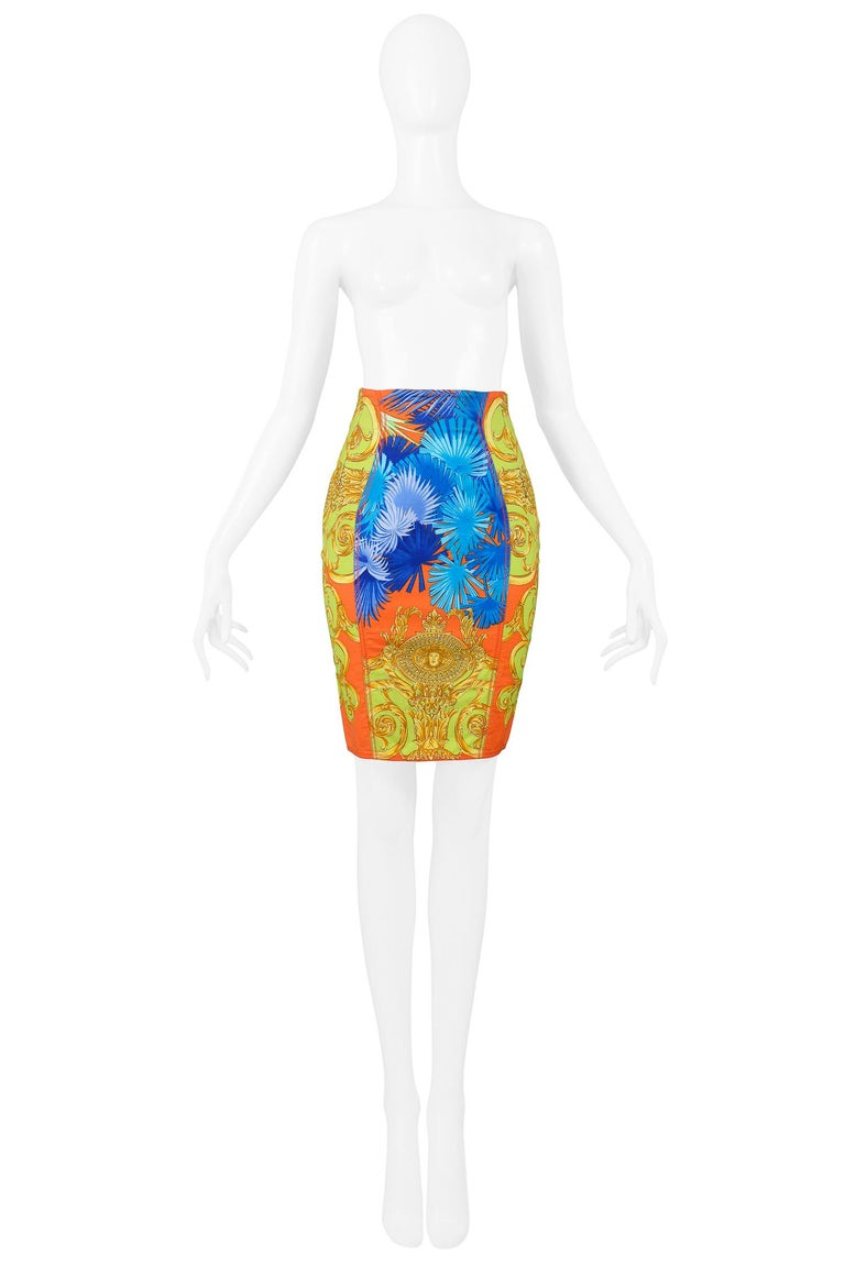 Vintage Versace orange, cobalt blue, and neon green cotton pencil skirt with palm frond and gold baroque-style print. Circa 1990s.  Excellent Vintage Condition.  Size 38