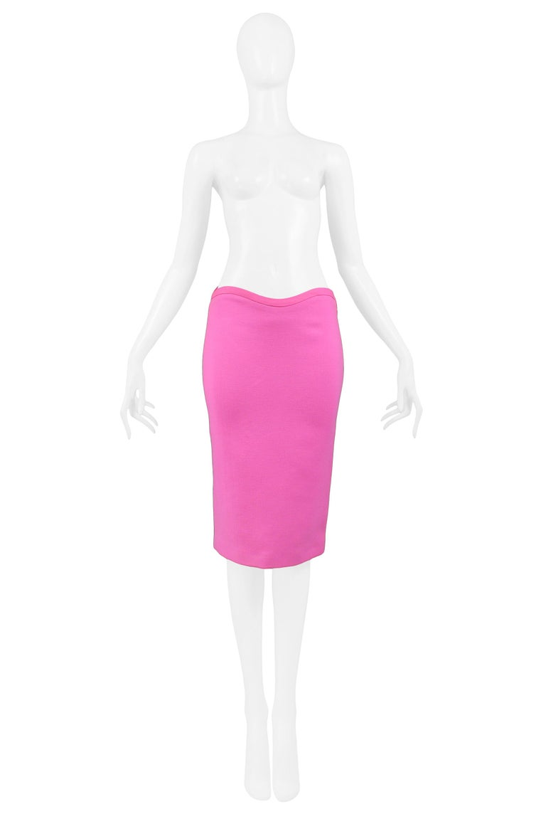 Vintage Versace bright pink pencil skirt featuring a curved waist detail and double slit at center back. Skirt has original tags. Collection 2002.   Excellent Vintage Condition.  Size: IT 38  Measurements: Waist 25-26