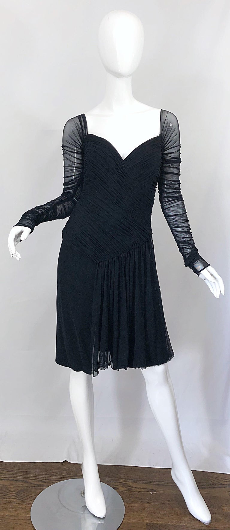 Beautiful vintage VICKY TIEL COUTURE mesh sweetheart neckline flirty little black dress! Features the designer's signature flattering ruched bodice (features interior boning to keep everything in place). Semi sheer long mesh sleeves. Fitted bodice