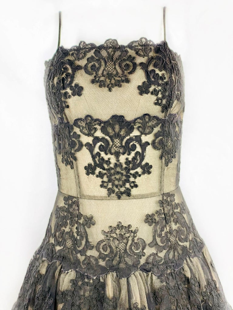 "Vintage VICKY TIEL Couture Paris Black Floral Lace Sleeveless Mini Dress Size S  Product details: Size S Black and beige floral lace  Noodle strap drop measures 5"" Rear zip closure measures 15.5"" Five layers skirt Made in France"