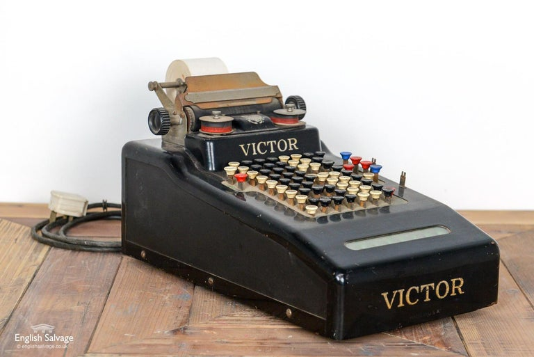 Vintage victor till, a little rusty and worn, as is to be expected with an item of this age. Keys move freely but the machine is untested, and would require an electrician's certification if to be used.