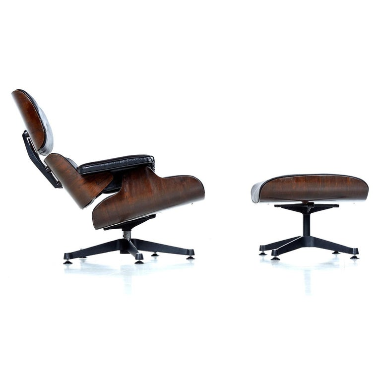 Sold as a pair. This set of vintage Eames lounge / ottoman replicas has an uncanny and unique history. We purchased from the original owners who actually had these commissioned while stationed overseas in Singapore in the 1970s. In hindsight, we