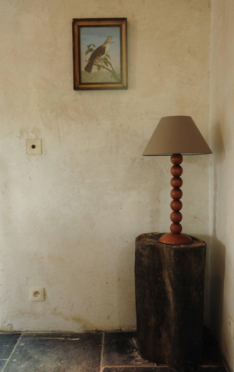 Beautifully turned walnut table lamp in a poppy, 1960s style. The creator of this lamp clearly was familiar with the quality of Classic woodturning and used this knowledge for a modern design. Its clean lines are accentuated by the warm rich color