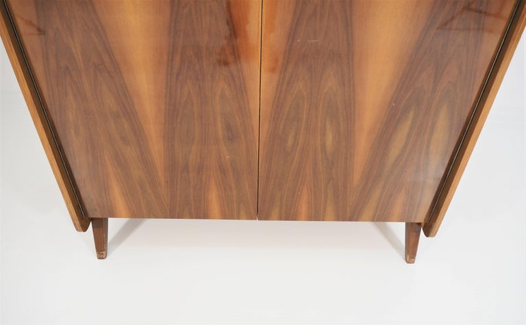Vintage walnut wardrobe from Tatra, circa 1960s. Very good original condition, beautiful and unique nut veneer. Dimensions: height 171cm, width 118cm, depth 51cm.