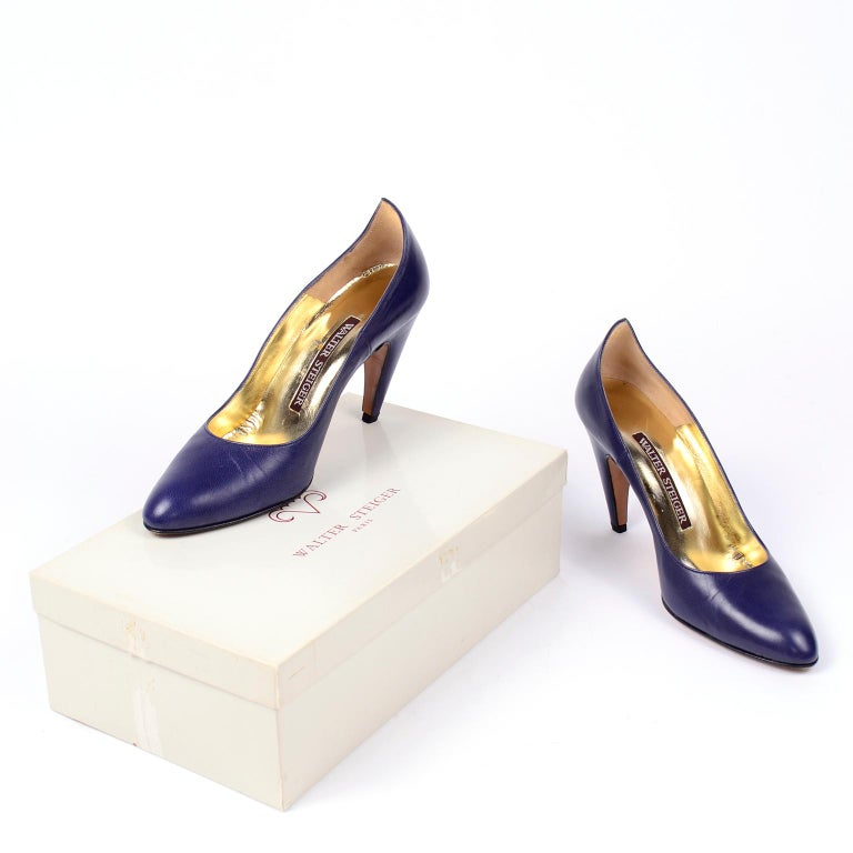 These incredible avant garde vintage Walter Steiger shoes make such a great fashion statement! They are in a wonderful royal blue leather and they have the Steiger signature unique curved heel that leads to a dramatic point at the back of the ankle.