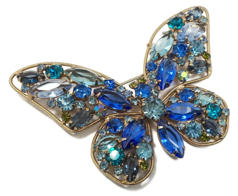 "This vintage butterfly 1960s brooch reminds me of Weiss.  It features multi-color crystals in a gold tone setting.  In excellent condition, this brooch measures 3-1/4"" x 2-1/8""."