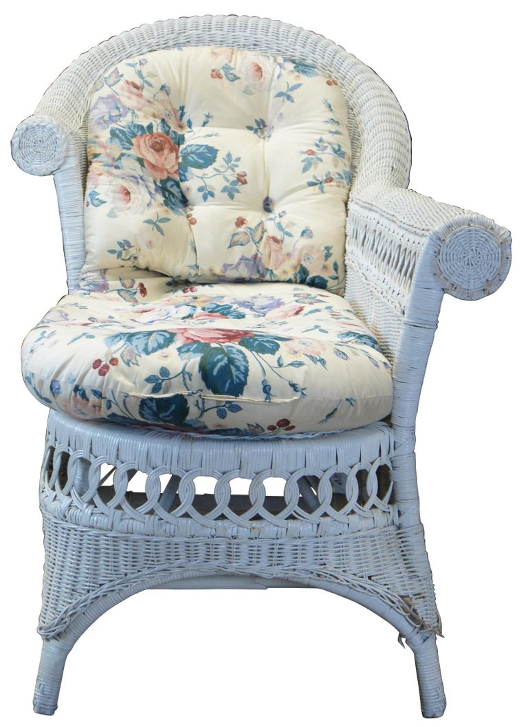 Vintage bamboo, wicker and rattan settee or lounge chair featuring a long rolled arm with circular braided wheel accent and interlocking rattan loop design.