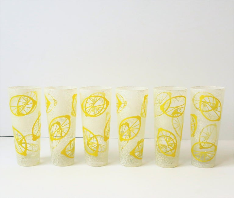 A beautiful and striking set of 6 vintage white and yellow highball beverage or cocktail glasses with 'lemon' design, circa Mid-20th century. This beautiful set has a slightly raised/textured design. Great for summer entertaining indoors or out, and
