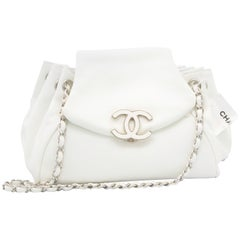 Vintage White Chanel Handbag with Matching Leather and Silver-Colored Strap