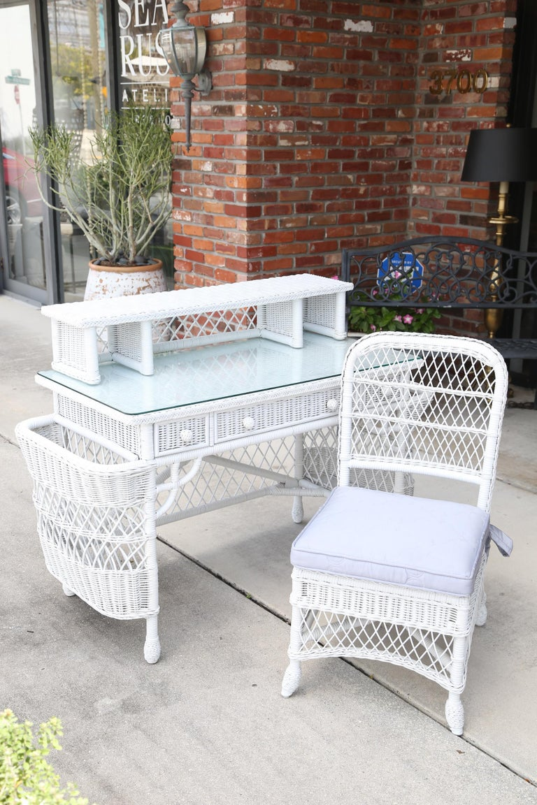 Henry link white wicker dressing table/ desk and matching chair.