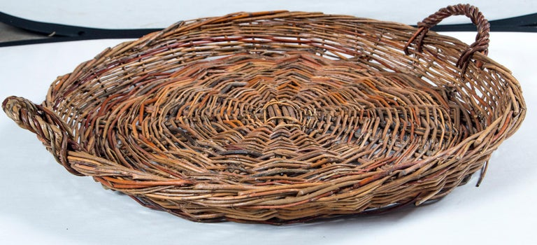 Vintage Wicker grape basket, France, circa 1950. Woven willow wicker with 2 handles. A vineyard basket used in the field during the grape harvest.