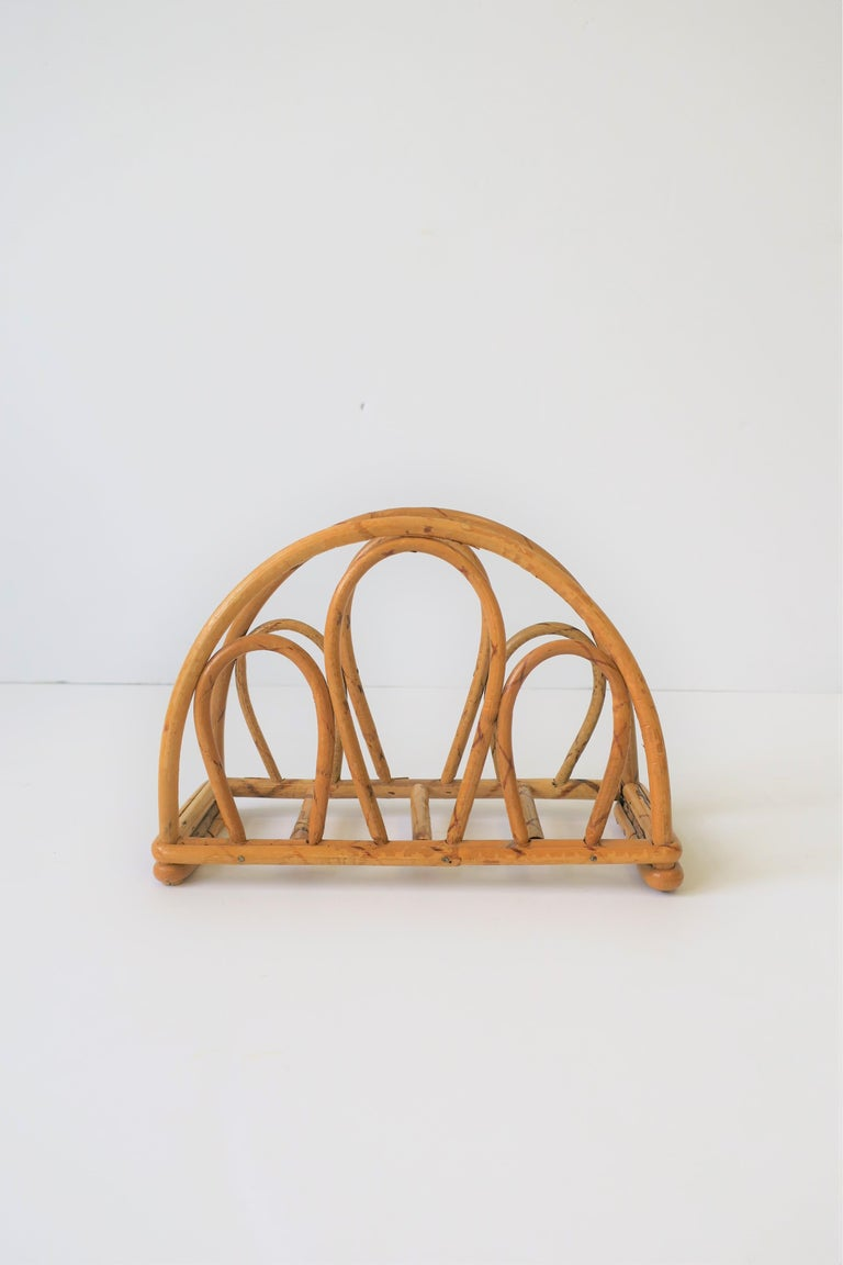 A beautiful vintage handcrafted bent wicker napkin holder.