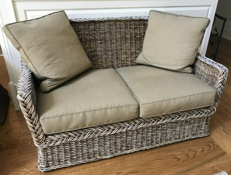 Contemporary wicker sofa with cushions. Great for garden patio or porch. Rattan, stick wicker.