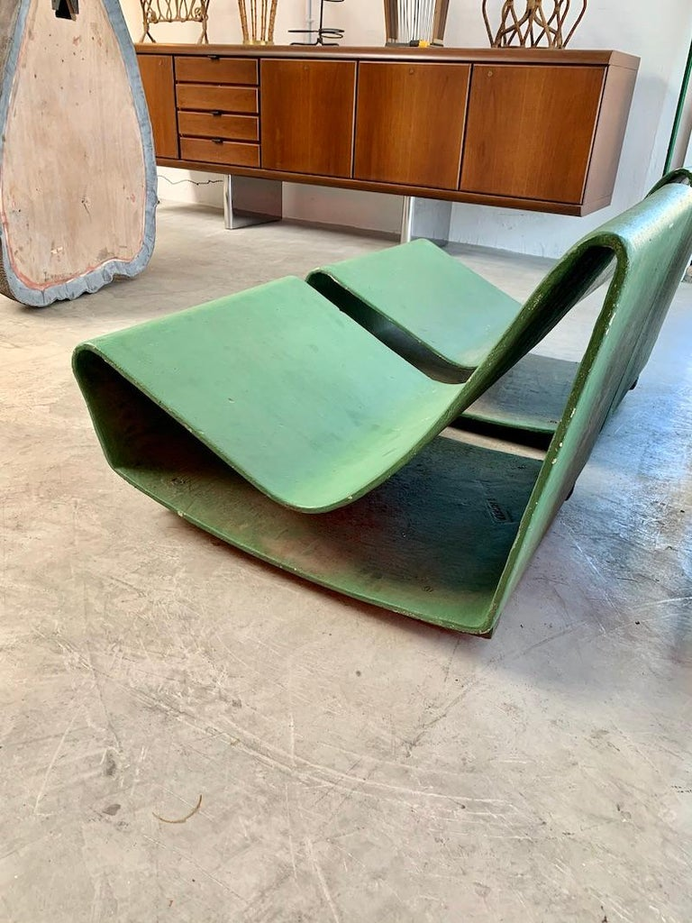 Rare set of vintage Willy Guhl Loop chairs from Rio de Janeiro, Brazil. These concrete chairs are getting increasingly difficult to find. Painted green years ago. Made in the early 1960s. The loop chairs from Brazil have a wood plinth base to