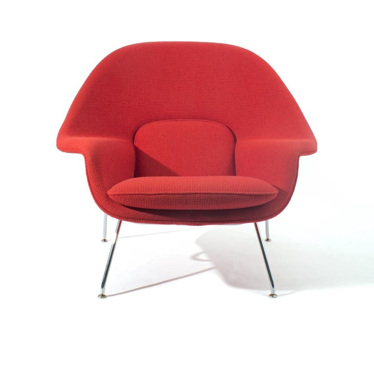 A vintage Womb chair by Eero Saarinen for Knoll with chrome base. Offered in COM.  USA, circa 2000-2010. Signed.  Measures: Seat height 16.5 inches.