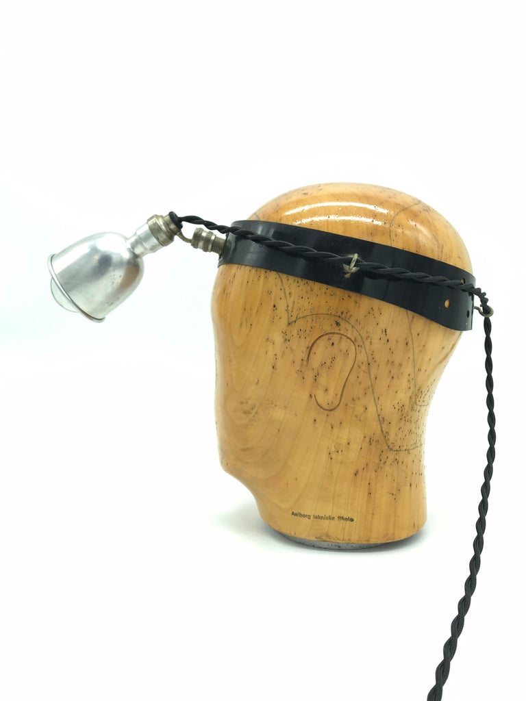Vintage hat or wig stand lamp. Made from a vintage wooden hat or wig stand and mounted with an antique medical inspection lamp A cool table lamp like no other The medical lamp has a small 6cm aluminum pressed shade and with a carbon filament