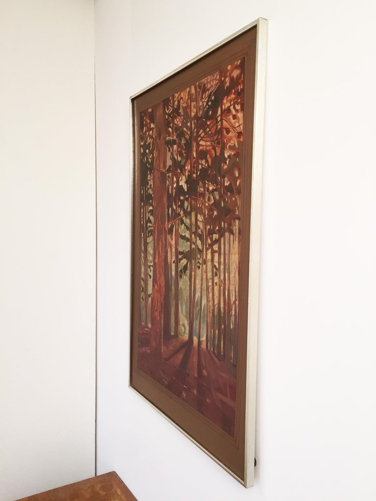 A vintage painting signed by Alan Healey and painted in the 1970s, depicting a sunny scene in the woods in the color palette of autumn. Framed in a chrome frame.