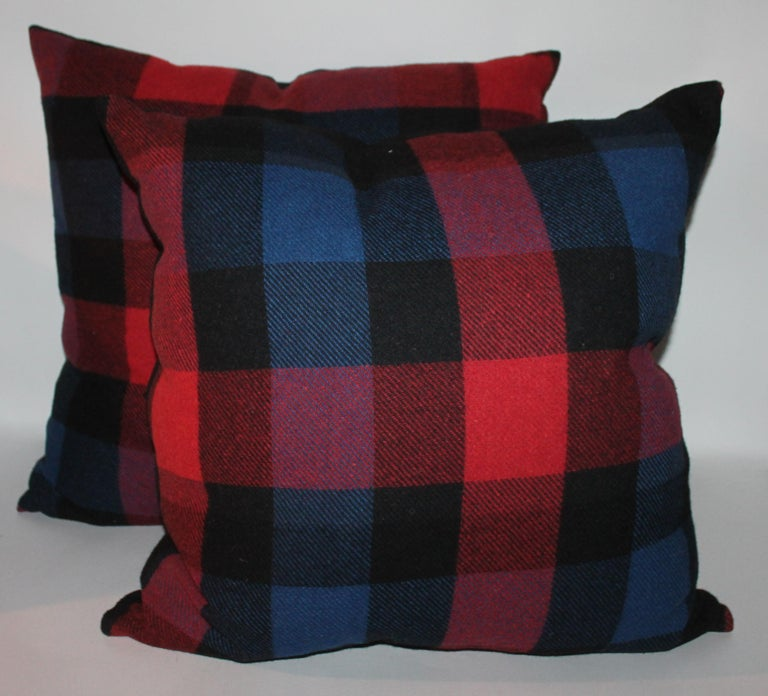 These vintage vibrant colors plaid blanket pillows are in fine condition and have cotton linen backing. Sold in pairs. Two pairs of each different color in stock. Measures: Small pair 20 x 20 Larger pair 22 x 22.