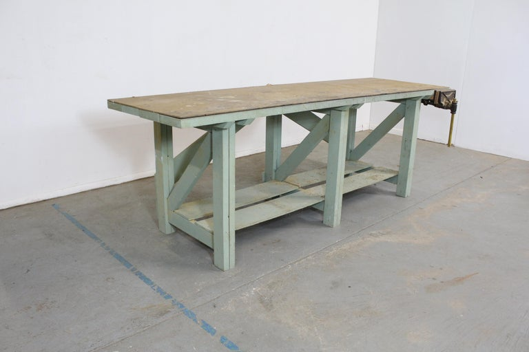 Vintage workbench with removable top  What a find. Offered is a vintage workbench that is estimated post 1950s. The top is removable and underneath there is a walnut stain on solid 2x6 planks that would make an excellent top. This is an actual