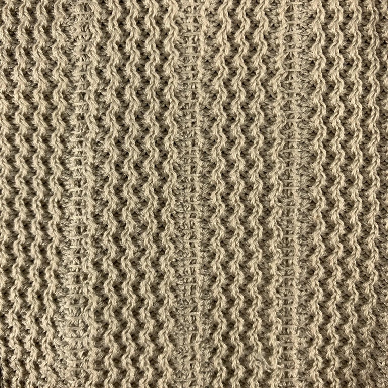 VINTAGE gloves comes in a taupe woven material with a brown suede trim.  Excellent Pre-Owned Condition. Marked: 8.5  Measurements:  Width: 4 in.  Length: 9 in.