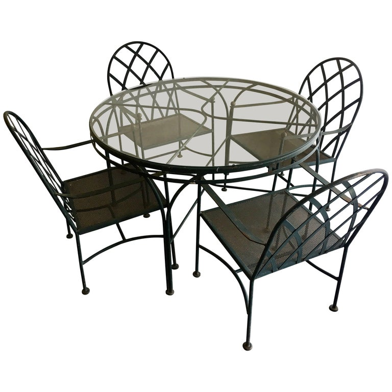 Vintage Wrought Iron Outdoor Patio Dining Set with Four Chairs For Sale