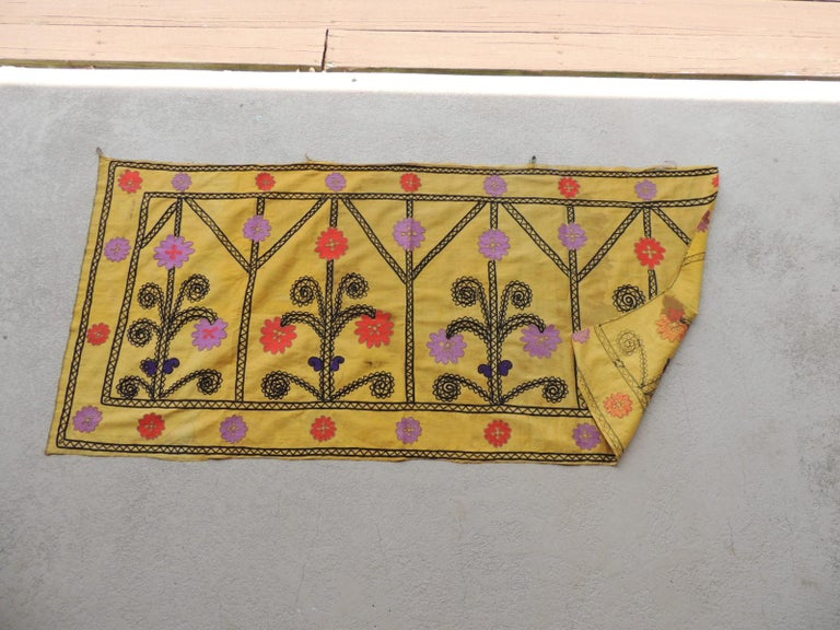 Vintage yellow and black embroidery Suzani textile panel.