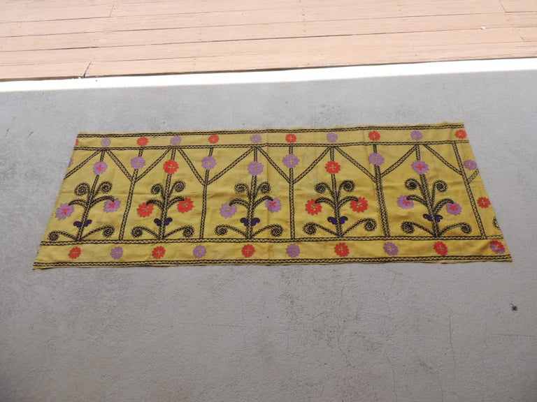 Vintage yellow and black embroidery Suzani textile panel. Depicting flowers and trellis pattern. In shades of lemon yellow, black, orange, red, blue and pink. Silk on silk embroidery. Sold as is: (stains are from aging) Suzani embroidery, which