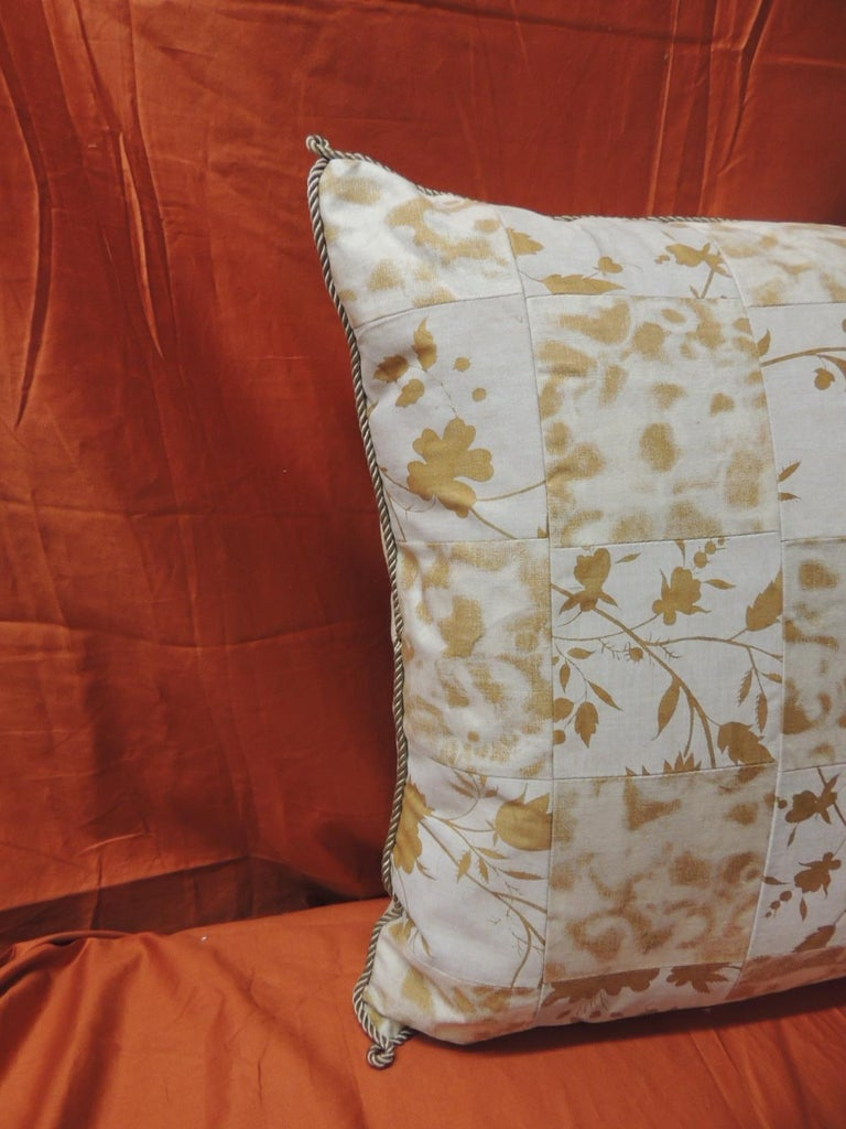 Vintage yellow and natural Fortuny patchwork square decorative handcrafted pillow with ATG custom patchwork design. Decorative pillow embellished with silk grey rope trim all around. Backing of the pillow finished with ecru silk. Decorative square