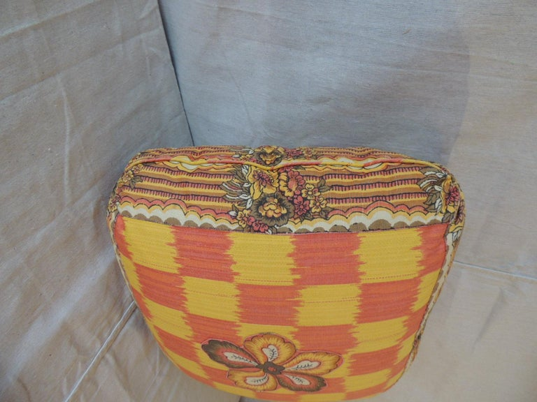 Vintage yellow and orange batik and Ikat decorative square pillow, Double sided, self welt, Turkish corners and applique flowers in the center of each pillow side. 100% down filled. Size: 22