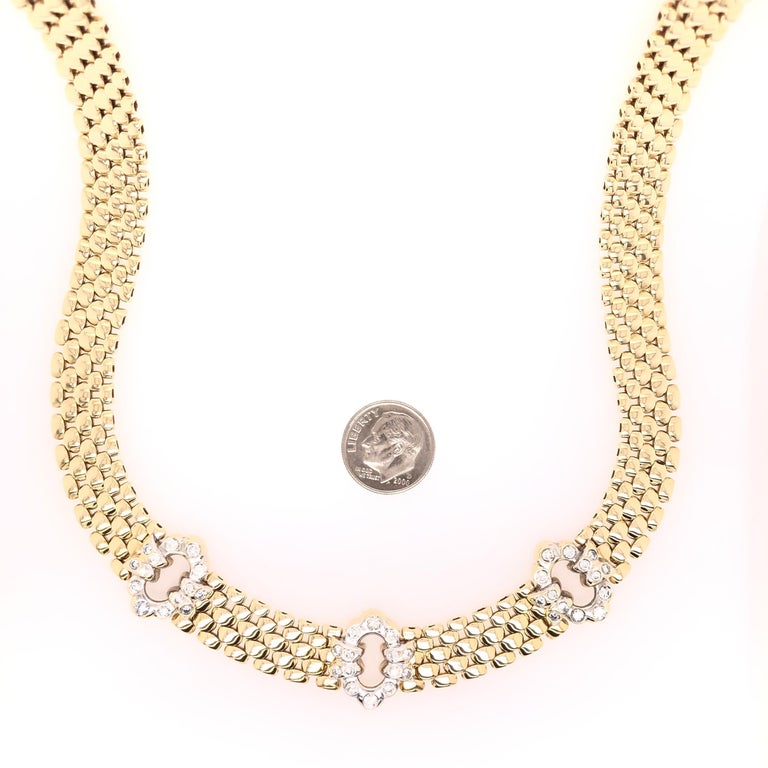 If you love vintage, this necklace is for you! Three flower inspired diamond stations are positioned front and center on a silky 14 karat yellow gold chain. A total estimated weight of 1.43 CTS of round cut diamonds are evenly and symmetrically