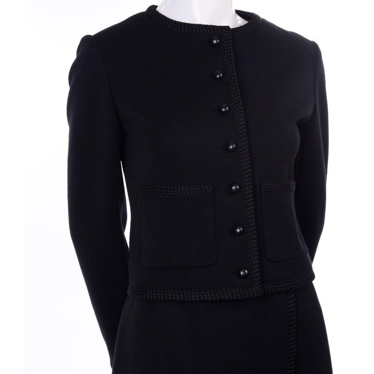 This is a timeless vintage YSL skirt suit that includes a boxy jacket and an A-line faux wrap skirt. It's hard to show the beautiful tailoring and details online with black garments, so I lightened one of the photos to try to give you an idea,  this