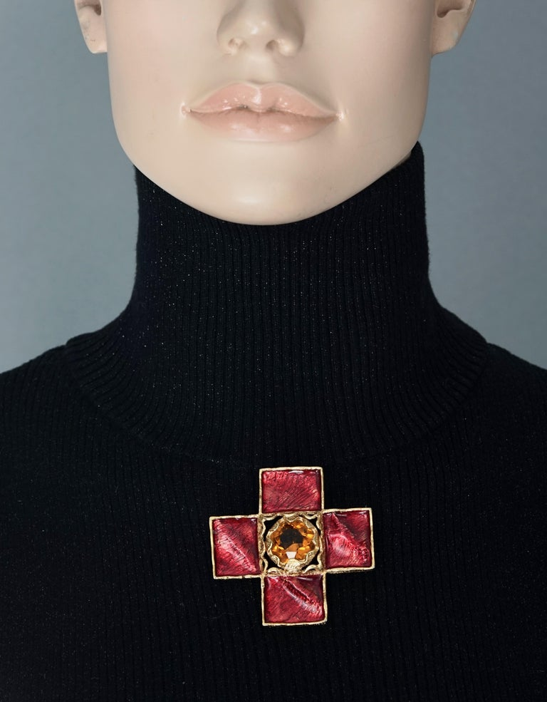 Vintage YSL Yves Saint Laurent by Goossens Wrinkled Red Cross Enamel Brooch   Measurements: Height: 2.4 inches (6 cm) Width: 2.4 inches (6 cm)  Features: - 100% Authentic YVES SAINT LAURENT by Robert Goossens . - Red wrinkled enamel cross brooch. -