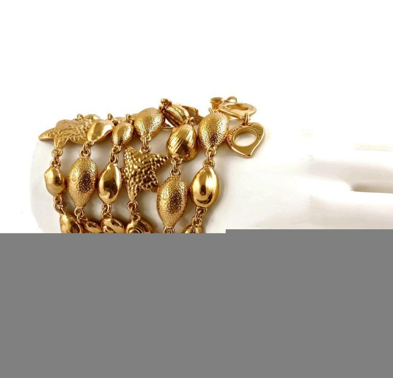 Vintage YSL Yves Saint Laurent by Robert Goossens Sea Shells Textured Bracelet Necklace  Measurements: Height: 1 inch (2.54 cm) Total Length: 43 6/8inches (111.12 cm)  Features: - 100% Authentic YVES SAINT LAURENT by Robert Goossens. - Articulated
