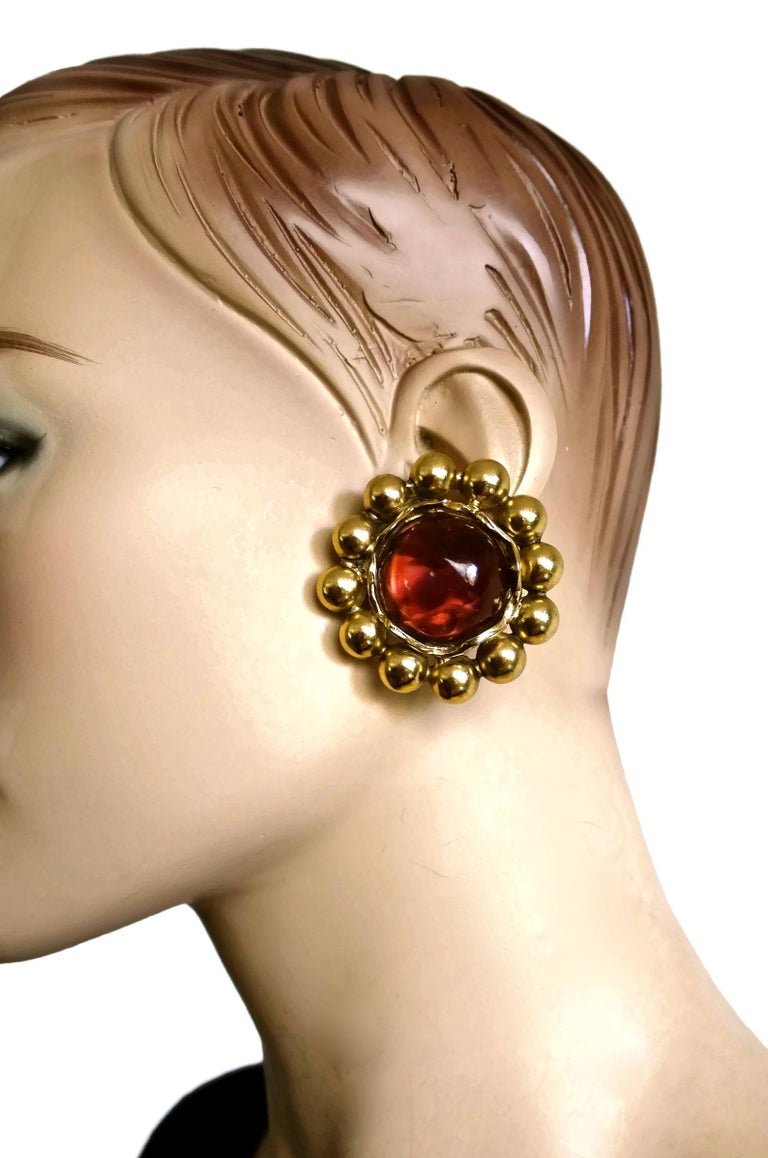 Vintage YSL Yves Saint Laurent Dark Amber Resin Poured Flower Earrings  Measurements: Height: 1.85 inches (4.7 cm) Width: 1.85 inches (4.7 cm) Depth: 0.43 inch (1.1 cm) Weight: 27 grams  Features: - 100% Authentic YVES SAINT LAURENT. - Flower